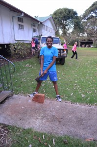 Jasmine trying her hand at cutting wood!